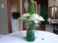 "I am party planner in the Barrington area and would love to share my ideas for a successful St. Patrick's Day party...out of a home. Last year, I planned a St. Patrick's Day party for a client and their 50 guests.       All guest received a personalized concert ticket as their invitation, (white ticket w/green font). The ticket set the stage for Drew's Famous St. Patrick's Day music (download for free off the internet) and the fun everyone was about to experience.      Green luminaries outlined the sidewalk and as guests reached the front door they kissed the Blarney Stone. (A boulder with the word Blarney painted onto it.)      There are no boundaries when it comes to decorating for St. Patrick's Day. Best part, it can be done economically. We used clear beer mugs filled with green water and fresh green carnations with baby breaths. (Clear beer mugs are at the dollar stores.) To help the mug illuminate throughout the night, I added green-glow-in-the-dark ice cubes in each mug. (Glow-in-the-dark novelties can be found just about anywhere.) Small four leaf clovers were scattered around the center pieces. To help their family room feel as if they were at a pub I rented a couple of ""pub"" tables ($10.00 each also known as highboy tables) and covered them with rented white linen. Clusters of green balloons are always festive for this type of party, just arrange them in corners of the family room and kitchen.   <div class=""thumbnail""><a href=""http://skitch.com/bizgirl/b8ywh/inbox-1681-messages-134-unread""><img src=""http://img.skitch.com/20090305-tkqq9t8gacewyeh4mkfehfcg5i.preview.jpg"" alt=""Inbox (1681 messages, 134 unread)"" /></a><br /><span style=""font-family: Lucida Grande, Trebuchet, sans-serif, Helvetica, Arial; font-size: 10px; color: #808080"">Uploaded with <a href=""http://plasq.com/"">plasq</a>'s <a href=""http://skitch.com"">Skitch</a>!</span></div>      Having a line at the bar is my pet pieve, so I had signature drink waiting for all guests. This really helps the party get started. The following was served:   St. Patty's Midori 1 oz Midori melon liqueur 1 oz whiskey sour mix 2 oz Sprite soda      Throughout the night you were able to drink a variety of beers, white wines, Bailey's Irish Cream, and/or Irish Coffee. Have all the drinks listed onto a menu card. This will help your guests know what's available. Knowing what drinks you're serving ahead of time will help figure out your budget for the party. If you're not worried about budget, by all means serve it all, it's St. Patrick's Day!   <div class=""thumbnail""><a href=""http://skitch.com/bizgirl/b8yie/inbox-1681-messages-134-unread""><img src=""http://img.skitch.com/20090305-tnn3a7yjrpsjuk3w8hx7qrknbh.preview.jpg"" alt=""Inbox (1681 messages, 134 unread)"" /></a><br /><span style=""font-family: Lucida Grande, Trebuchet, sans-serif, Helvetica, Arial; font-size: 10px; color: #808080"">Uploaded with <a href=""http://plasq.com/"">plasq</a>'s <a href=""http://skitch.com"">Skitch</a>!</span></div>      Along with the corn beef and cabbage, I also served artichoke and spinach dip, cucumber canapes, green grapes, caprese on skewers, guacamole, green salsa and chips, a variety of white cheeses, mixed nuts, just to name a few. Be creative when serving your food. I used small martini glasses for the nuts and chocolates. Find an old slate to serve the cheeses and make sure to add color to the cheese platter with grapes, green melons, and nuts. Try serving the corn beef and cabbage onto platters lined with the potatoes and carrots.   <div class=""thumbnail""><a href=""http://skitch.com/bizgirl/b8yiu/inbox-1681-messages-134-unread""><img src=""http://img.skitch.com/20090305-rmsah51ytfc7y4np346pk21mds.preview.jpg"" alt=""Inbox (1681 messages, 134 unread)"" /></a><br /><span style=""font-family: Lucida Grande, Trebuchet, sans-serif, Helvetica, Arial; font-size: 10px; color: #808080"">Uploaded with <a href=""http://plasq.com/"">plasq</a>'s <a href=""http://skitch.com"">Skitch</a>!</span></div>      Using upscale plastic and forks definitely fits into this party....remember you're running a pub for the night....put your china away!      Lastly, entertainment and games. I asked our local Irish Dancers to come and perform a 20 minute routine, half into the night. (By that time, most dancers have finished performing at the parades/schools.)    For my client's party we asked each guest to participate in a Limerick competition. Give each guest paper/pen and ask them to make up a limerick. You may want to give them some ideas for topics like leprechauns, maidens in distress, four leaf clover, dragons etc. I found some original limericks on the internet and had the host read them out as examples. The winner of the competition walked away with a gift basket. The gift basket was filled with everything you would want for the morning after: aspirin, muffins, tea, etc.      As host of your party, make sure to toast and wish everyone a little luck of the Irish with wee bit o'fun!!!   This fabulous St Patrick's Day party idea was brought to you by Christina Currie of <a href=""http://www.partypartnerinc.com"">Party Partner, Inc</a> party"