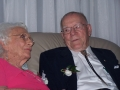 "After 65 years of marriage, Mr. and Mrs. Frances Jefferson renewed their vows on March 16, 2007 at 7pm. The ceremony took place at their youngest daughter�s home in Tucson, Arizona. Approximately 45 guests attended, including close friends and family, to witness the joyous occasion. A priest from the Jefferson's beloved Our Mother of Sorrows Catholic Church conducted the ceremony and mass followed by appetizers and champagne.  Mr. and Mrs. Jefferson met in Tucson, Arizona in 1942 at the Sword and Key Club. In attempts to get noticed, Mr. Jefferson would jump off a 30 foot diving board cannon ball style into a swimming pool and splash Mrs. Jefferson. It worked. At that time Mr. Jefferson was in the airforce and was stationed in California. Two weeks after meeting each other, Mrs. Jefferson packed up her car and drove to California to be with her love. During those days the roads were not paved and it was not lady-like to drive far distances. This did not stop Mrs. Jefferson. They were married 3 months later. Now with 5 children, 11 grandchildren, and 11 great grandchildren they renew their vows to one another.  The wedding ceremony and mass was momentous. First, the house filled with voices singing ""Amazing Grace how sweet the sound"". Then passages from the bible were read aloud by family members followed by the exchanging of vows. Witnessing two people so much in love after 65 years was a gift in itself. Mrs. Jefferson looked radiant in her hot pink knee length dress while she recited and received her vows. Mr. Jefferson appeared very proud as he looked at his wife and at everyone in the room whom they love and are connected to. Next the priest led us in Holy Communion followed by statements made by their children and their spouses regarding the impact that their marriage and love has had on them.  After the final prayer, it was time to celebrate. Appetizers and champagne filled the rooms. The appetizers included a cheese plate with crackers and veggie plates. This was perfect considering we all ate before the ceremony. Champagne was poured into flutes that had the names of guests of honor and the date on them. A two-tiered wedding cake with little hearts was cut and distributed. The main topic of discussion was how happy and grateful everyone was to be together.  Although I was brought into the Jefferson family by the marriage of my mom to my step-dad, I have never felt like an outsider. This is because of the wonderful family values that Mr. and Mrs. Jefferson have instilled in others. I am honored to have witnessed the exchanging of vows after 65 years of marriage. party"